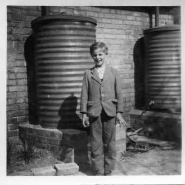 Brian Pepper standing by one of the rain water butts at the back of Allerton Terrace c1960 | Brian Pepper