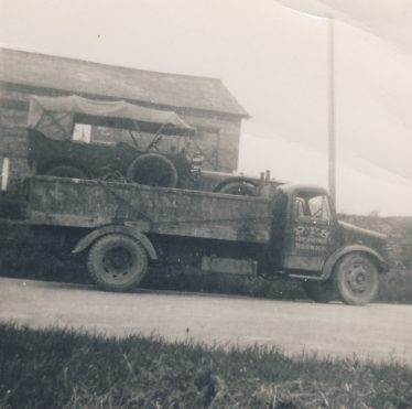 The old Straker-Squire on the back of a lorry at Meldreth Railway Station in 1949 as told by John Gipson in the audio clip above. | Brian Pepper