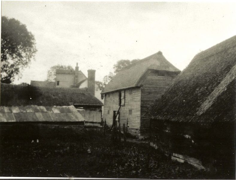 Outbuildings at Topcliffe Mill in the 1930s.<br>The mill granary (since converted to a house) can be seen in the centre of the photograph. | Cambridgeshire Collection