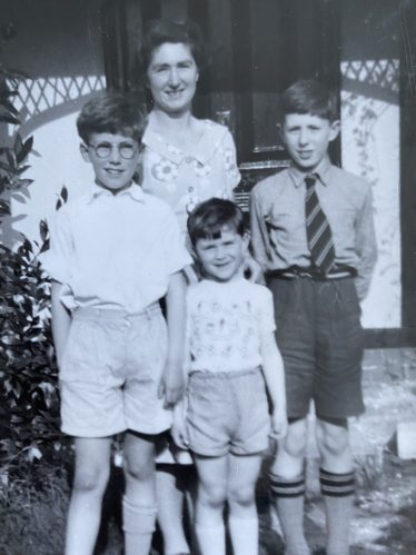 The Pinney Family, 1957, outside Kelston Cottage, 116 High Street, Meldreth. <br>Left to Right: Robert (9), Sheila (mother), Alan (4), David (11) | Alan Pinney