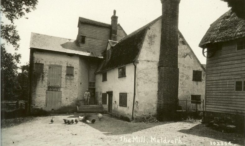 This photograph, taken in the 1920s, was taken from very close to one of the other outbuildings seen in the photograph above. The thatch of one of those buildings can be seen in the top right hand corner of this photograph. | Bell's Postcard