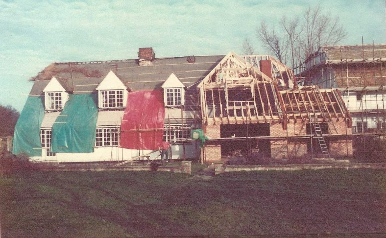 The southern elevation of the house, taken in December 1983 when the thatch was being removed and the house extended | Photograph supplied by Andrew Emerson