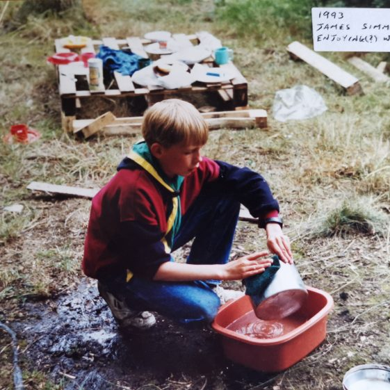 James is enjoying (?) the washing up, 1993 | Photograph supplied by Stephen Marshall