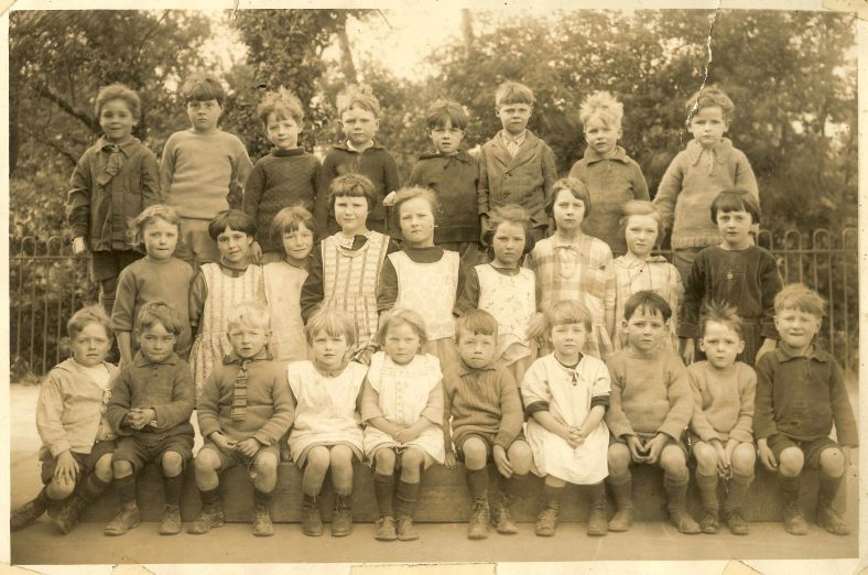 <b>Class 1, c. 1928</b><br> Back row, from left: Dennis Pepper, Jason Palmer, James Light, Cyril Harper, Donald Barnes, Harold Croxall, John Gipson, Gordon Handscombe<br> Middle row, from left: Peggy Cox, B East, ?, Beatrice Light, Gladys Waldock, Flora Waldock, Gladys Wing, Helen Waldock, Violet Gentle<br> Front row, from left: Wilfrid Butler, Neil Dash, James Winter, ?, Tessa Prime, Stanley Gentle, Margaret Jacklin, Eric Andrews, Eddie Andrews, Ken Waldock<br> | Photograph supplied by Ann Handscombe