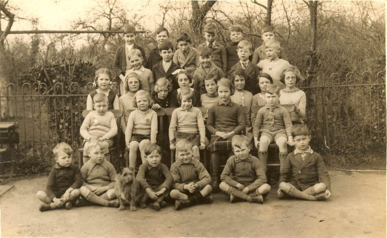 <b>The entire school, 1938</b><br> Back row, from left: Gerald Abrey, Norman Plumb, Dennis Wisby, Jack Farnham, Vic Hale, Reg Carter<br> Second row, from left: Rodney Plumb, ?, Bernard Howell, Albert Dash, Stan Pearce<br> Third row, from left: Heather Paterson, Sylvia Stubbing, Millie Dash, Enid Fost, Mary Stubbing, Angela Pepper, Doreen Farnham, Joan Stubbing<br> Fourth row, from left: Freddie Pearce, Daphne Stubbing, Edna Beane, Jean Wing, Eric Pateman<br> Front row, from left: Tony Hale, Dennis Dash, Gip the dog, Roy Rumble, ?, ?, Dennis Oakman | Photograph supplied by Dennis Dash