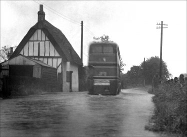 Sheene Cottage 1950s - the gable end and road flooding | Melbourn Local History Group