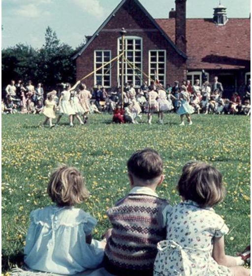 Julie Handscombe, Keith Saunders and Elaine Handscombe watch the maypole dancing | Photograph courtesy of Ann Handscombe