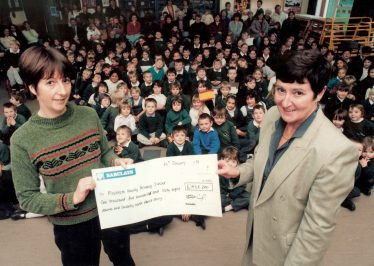Barbara Gowling (left) of the PTA, presenting the cheque to Mrs Brown | Photograph courtesy of Meldreth Primary School