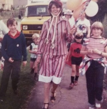 Betty leading some children to the Village Hall for a party she had organised to mark the 1977 Silver Jubilee | Photograph supplied by Ann Rogers