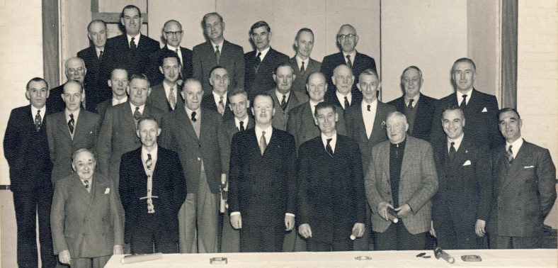 25 Year Service Dinner at The Atlas<br> Back Row, L to R: _____, Lol Cooper, Sid Chamberlain, ____, Mr Prime, _____, _____<br> Middle Row, L to R: Bob Woods, Mr Pullen, George Winter, ____, Freddie Briggs,____, Bert Pilgrim, _____, ______, ______, ______, Bill Thurley, Frank Turvey, Dave Huggins.________.<br> Front Row, L to R: Percy Winter, Mr Davis, _____, Bill Wing snr, _____, ______. | 1940s?