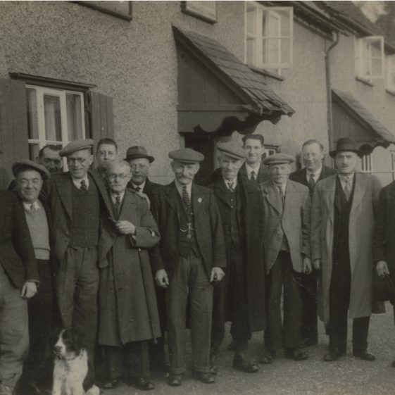 Frank Cooper, Sid Cooper, Joe Cox, Fred Farnham, Percy Farnham, Bert Gipson, Alf Jacklin, Harry Swain, Eustace Waldock and Montgomery Wing standing outside the British Queen Public House, Christmas 1942 | Photograph supplied by Sylvia Gipson