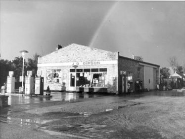 The garage and filling station in the 1960's. The chimney of Woolpack Cottage can just be seen to the left of the garage. This was demolished in the mid 1960's