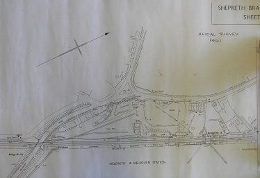 Aerial Survey of Meldreth and Melbourn Station and Goods Yard in 1961 showing the layout of the sidings.  Also notice the number of allotments around the area including beside the railway track.  No space was wasted. (Click on the image to enlarge)   Chelmsford Record Office