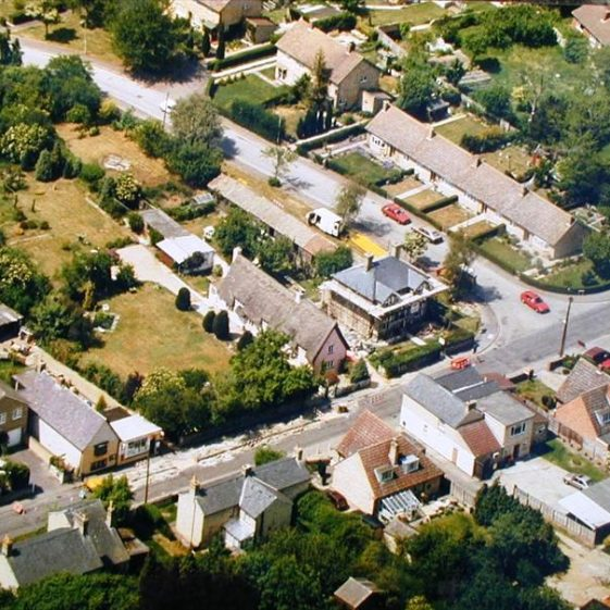 Aerial view of High Street, Meldreth showing Bell Close and the Old Bell P.H.  c. 1990 | Photo supplied by Avril