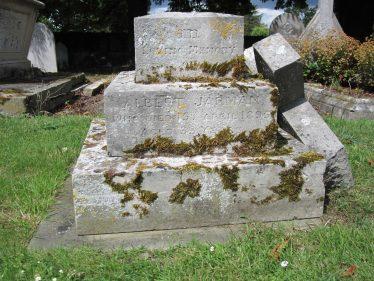 Albert Jarman's gravestone in Holy Trinity churchyard. The inscription reads,
