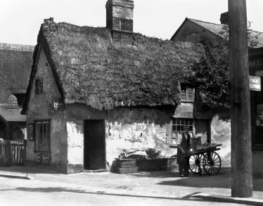 Alf Hinkins outside his shop in Melbourn | Photograph supplied by Melbourn History Group