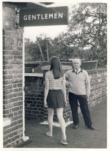 Photo used in newspapers in September 1970 illustrating a gentleman standing guard whilst a lady uses the Gentleman's toilet. (see article below) | Unknown origin. Photo provided by John Chamberlain