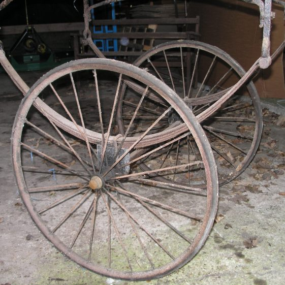 The wheels on the bier.  Note the carriage leaf springs. | Photo by Tim Gane