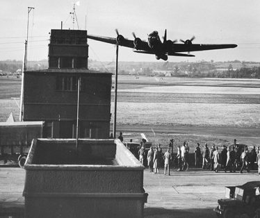 A World War II bomber takes off over the Bassingbourn airfield tower | Tower Museum, Bassingbourn