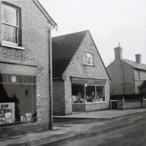 The Bee-Ive shop next to Allens Stores, High Street, Meldreth.  1965 | Photo supplied by Meldreth W.I.