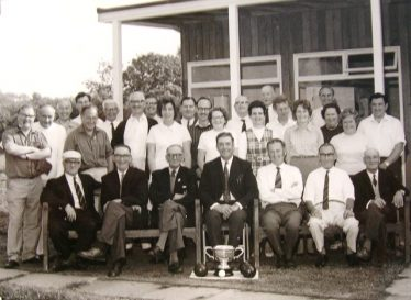 Meldreth Bowls Club in 1972. Dennis is seated in the centre, behind the trophy with Dorothy stood behind him. | Photograph supplied by Alison Chalkley