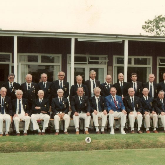 Members of Meldreth Bowls Club with the President of the English Bowling Association, photographed on 9th June 1992 to mark the occasion of the Club's Diamond Jubilee.  Back row, from left to right: W Butler, Roger Mead, Keith Jacklin, John Stubbings, Roy Thompson, Reg Carter, Ken Lee, Tom Jude, Vernon French, Tony Barker, Mike Hardiman, Ken McLean, Harry Tucker.  Front row, from left to right: John Ford, Ray Hardman, John Gray, Henry Kitchener, Fred Sims, Bill Parkin, Ken Singleton, EBA President Mr R Jack MBE, John Chalkley, Nobby Oakey, Geoff Brooks, John Harris | Photograph supplied by Keith Jacklin