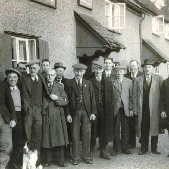 A group of locals outside British Queen P.H., High Street, Meldreth. Christmas 1942 | Photo supplied by Sylvia Gipson