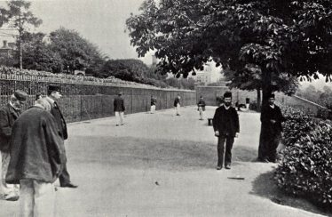 The Terrace at Broadmoor, c. 1908. The patients are wearing the distinctive Asylum clothing of dark blue jackets and grey trousers.  Their clothes and shoes were made on site. | Berkshire Record Office
