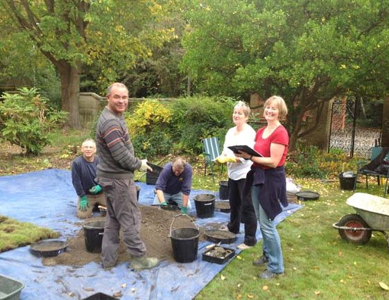 Members of Meldreth Local History Group working on the test pit at Maycroft Care Home | Photograph by Lynn Ward