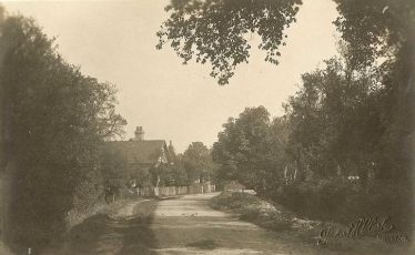 Chiswick End, Meldreth in the 1930s.  Chiswick Farm is in the background.  The scene is little changed from the photo above. | Robert Clarke postcard