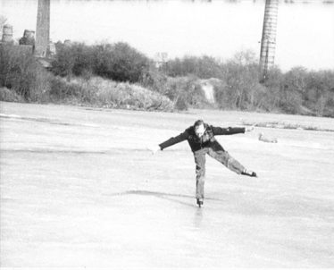 Raymond Course skating at the lime pit behind Cam Farm in 1942 - some of the industrial buildings are still visible | Photo supplied by Raymond Course