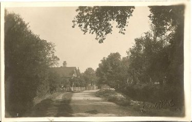 Chiswick End in the 1940s. Chiswick Farm is in the background. The scene is little changed from the photo above. | Robert H Clark postcard supplied by Ann Handscombe
