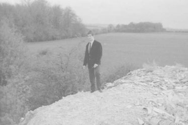 Ron Winter, standing on the asbestos dump with woods No. 1 & 2 in the background. c. 1960. | Photograph supplied by Ken Winter