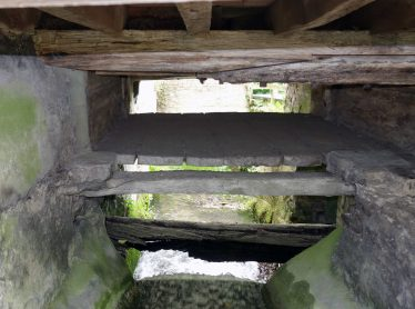 The mill race showing the pentrough and wheel axle, May 2017 | Photograph by Kathryn Betts