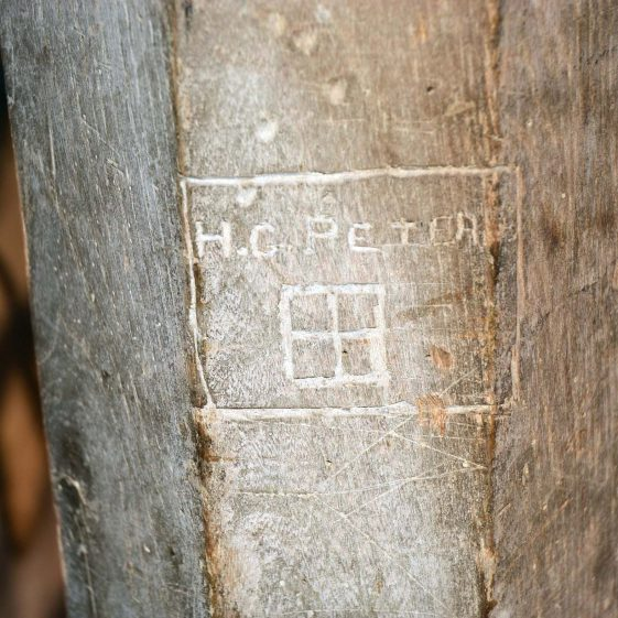 Ground floor: H G Peters' initials are also carved in one of the wooden pillars, December 2013. | Photograph by Kathryn Betts