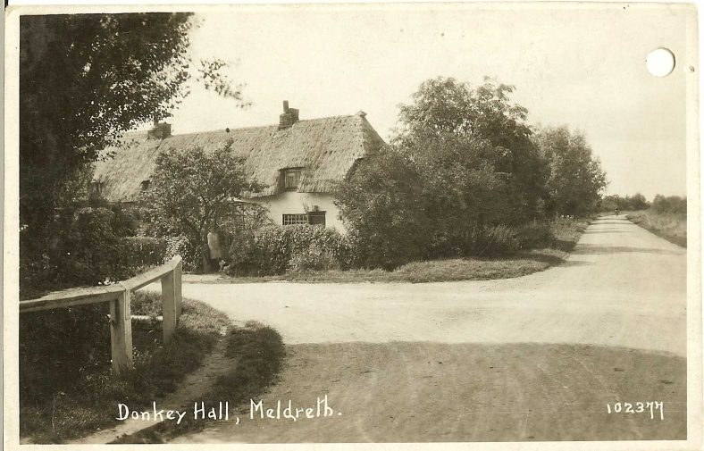 102377 Donkey Hall, Meldreth<br> Taken before the early 1930s.  These cottages were pulled down by Charlie Plumb after 1931 when the residents were re-housed in the newly-built council houses in Kneesworth Road (now West Way).  See 102347 above.  | Bell's postcard supplied by Ann Handscombe