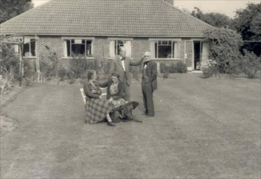 (16) Ethel and Fred Walford (centre) in the garden of the Coppice, North End, in 1961 | Photograph supplied by Michael Walford