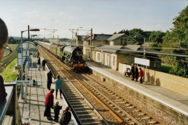 Flying Scotsman passing through Meldreth Station in 2000