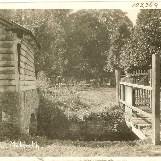 Mrs Sheldrick on the bridge over the River Mel at Flambards, c.1930 | Bell's Postcard supplied by Ann Handscombe