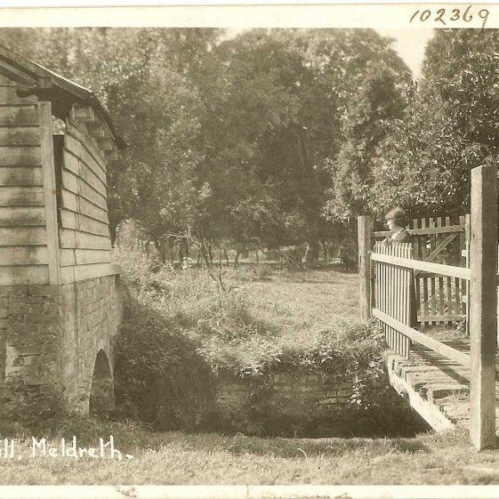 Mrs Sheldrick on the bridge by Flambard's Mill, 1930s | Bell's Postcard supplied by Ann Handscombe