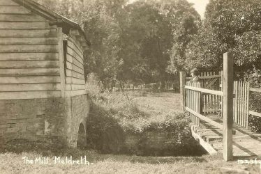 Mrs Sheldrick on the bridge at Flambards Mill | Bell's Postcard supplied by Ann Handscombe