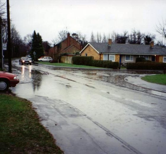 Floods at in High Street at the corner of Elin Way, Meldreth. 1990 | Photo supplied by Ann Handscombe