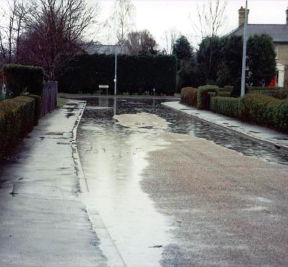 Floods in Elin Way with the junction of High Street, Meldreth.  1990 | Photo supplied by Ann Handscombe