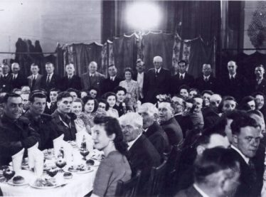 Meldreth Football Annual Dinner Back Row l/r ?, Montgomery Wing, Jim Winter, Ken Waldock, ?, George Palmer, Fred Sims, Daisy Dainty, Don Peacock, Adrian Pearce, Eddie Waldock, Bernard Kenzie, William Newell, Mr Howell.  Middle of 2 l/h men Ken Jacklin  Middle of 2nd and 3rd men front l/h side of table Don James  5 ladies in front of Daisy Dainty from b/f Hazel Simms, Mavis Simms, Muriel (Doddie) Winter nee Hunt, Margaret Waldock, Lo Howell  Lady in front of Eddie Waldock Mrs Fred Simms  4 people in front of Bernard Kenzie Mrs Dazely, Muriel Gipson, Mrs Joe Cox, John Gipson  4 people in front of Bill Newell l/r Reg Catley, Mrs George Harper, George Harper, Mrs William Newell  Lady and man front r/h of table Margaret Jacklin, Herbert Jacklin  Second from front extreme r/h side Donald Barnes | Ann Handscombe