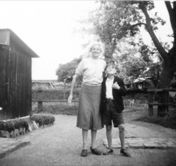 Helena Fost with grandson Stephen Martin outside her home in Allerton Terrace, High Street, Meldreth. c.1959 | Photo supplied by Enid Martin