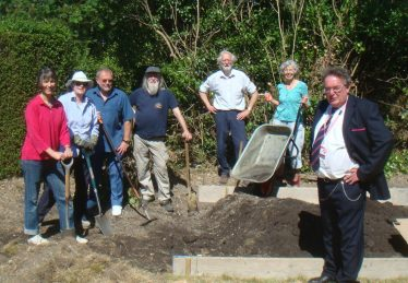 Some of the volunteers who have worked to prepare the station garden and planters at Meldreth Station. L to R: Susan van de Ven, Ann Thompsn, Tim Gane, Bruce Huett, Peter Draper, Ann Barnes, David Piggott | Susan van de Ven
