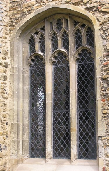 The southwest window of the chancel is also of 15thc date with similar vertical emphasis as the windows in the south aisle. | Peter Draper