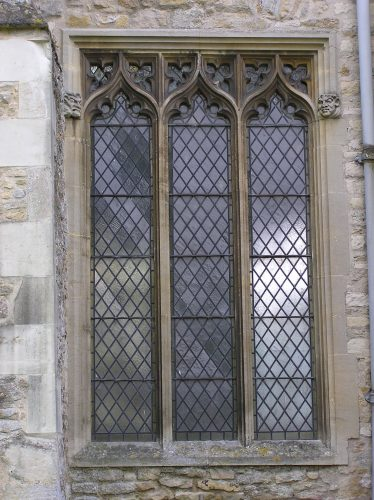 The east window in the north wall of the nave.  The square head of this window and the revived use of ogee (reverse curve) arches indicate a 16thc date for this window (though it is much restored). Could it be that this window was inserted when the altar was moved from the chancel to a position in front of the screen and more light was needed in this part of the church? | Peter Draper
