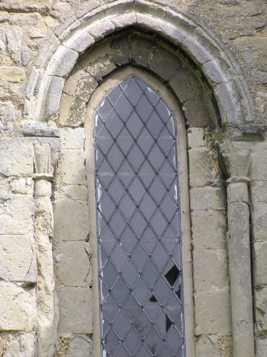 Window on the lower stage of the tower, with scallop capitals | Peter Draper