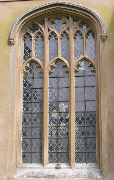 South aisle window with so-called Perpendicular tracery in which the head of the window is made up of rectilinear panels and vertical mullions run through to the window arch. The shallow four-centred arch (the profile of the arch is struck from four different compass points) is typical of the 15thc. | Peter Draper